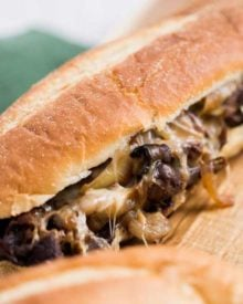 Juicy ribeye steak, caramelized onions and mushrooms, gooey provolone cheese and a mouthwatering horseradish sauce... it's the perfect All-American Cheesesteak! | #cheesesteak #phillycheesesteak #hoagie #sandwich