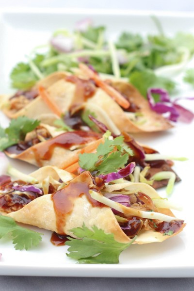 Want to make some Slow Cooker Hawaiian Pork Wonton Tacos?
