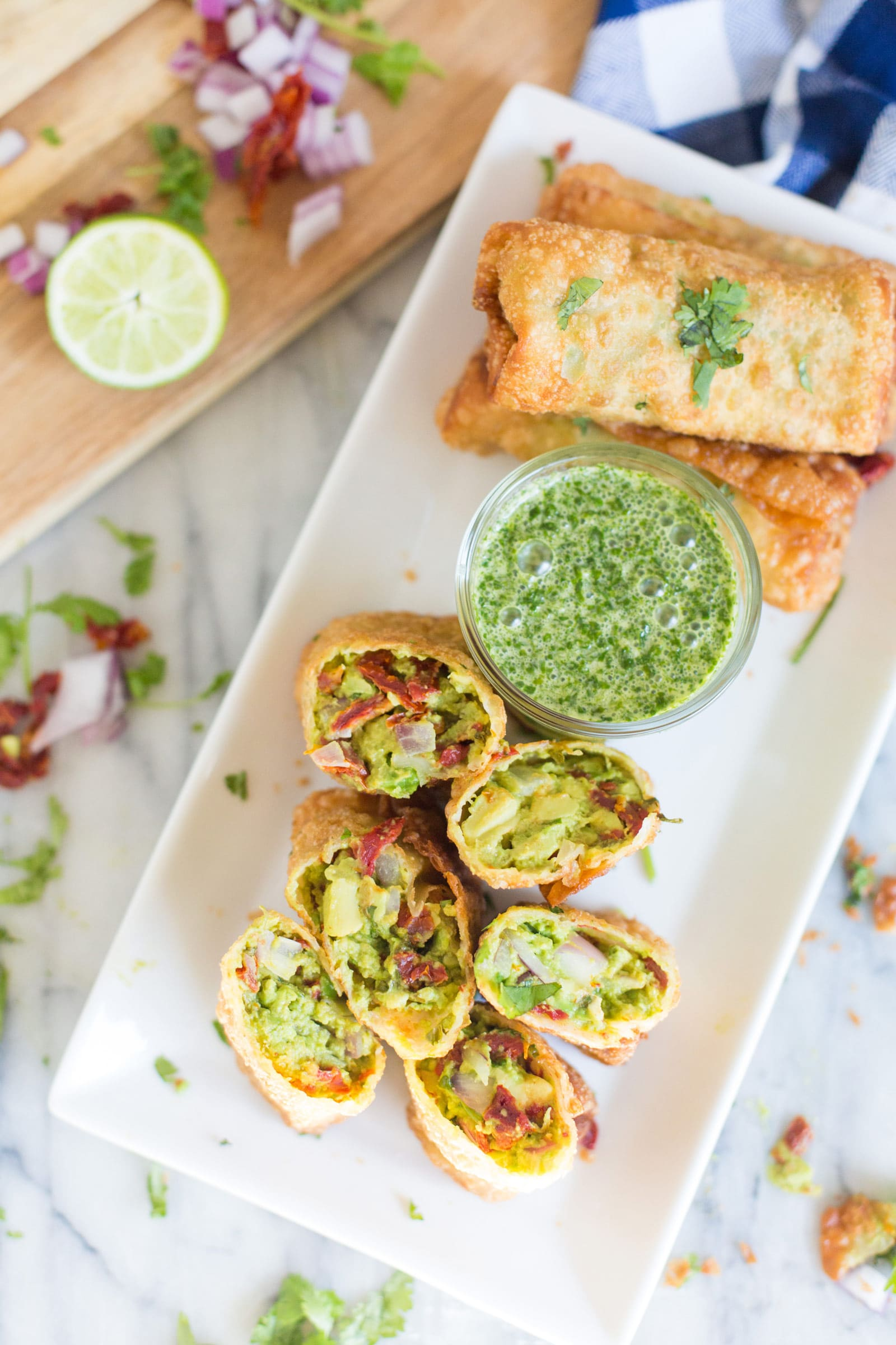 Copycat Avocado Egg Rolls | A copycat of The Cheesecake Factory's avocado egg rolls, this recipe is loaded with amazing flavors and served with the most delicious honey cilantro dipping sauce!  Not a spot on copycat, but one made with easy to find ingredients! | https://www.thechunkychef.com | #appetizer #copycat #eggroll #avocado #party