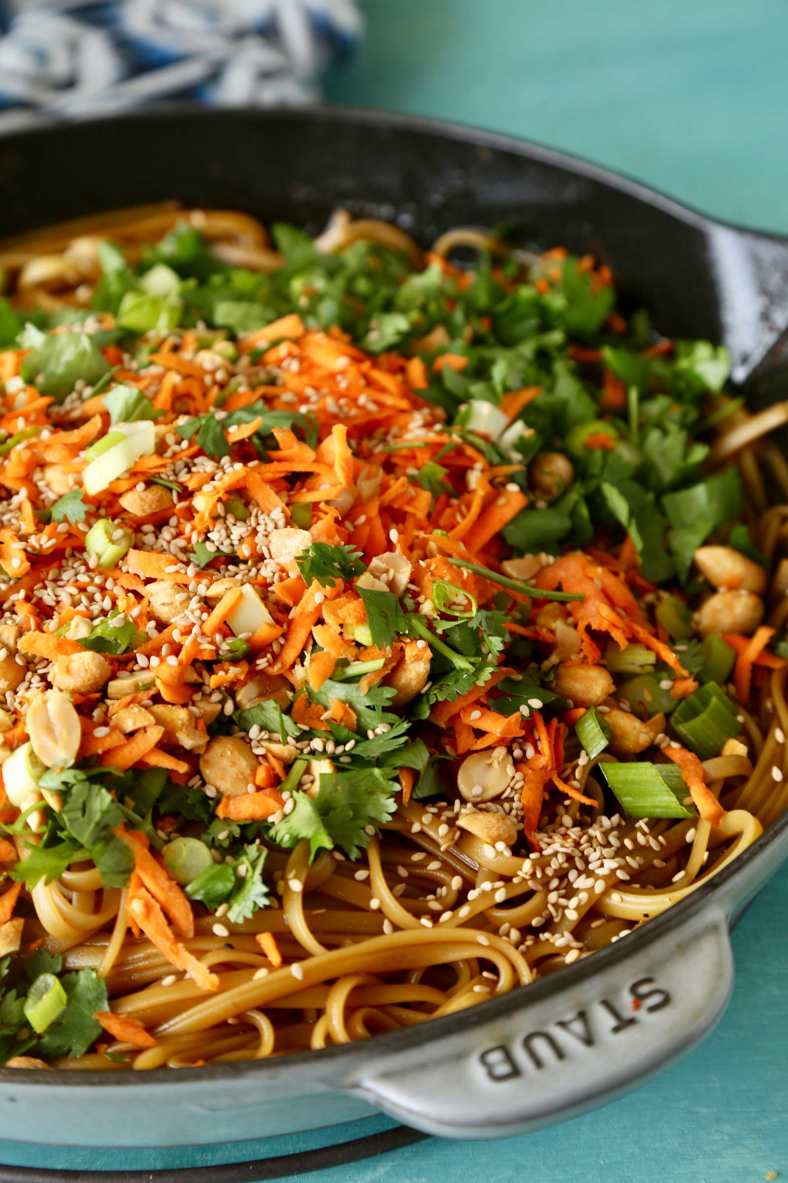 Spicy Thai Noodles | Ready in just 20 minutes, these spicy Thai noodles are made with everyday ingredients and insanely flavorful!  This recipe is vegetarian, but optional protein additions mentioned in post! | The Chunky Chef | #easyrecipe #thai #noodles #weeknightdinner #vegetarian