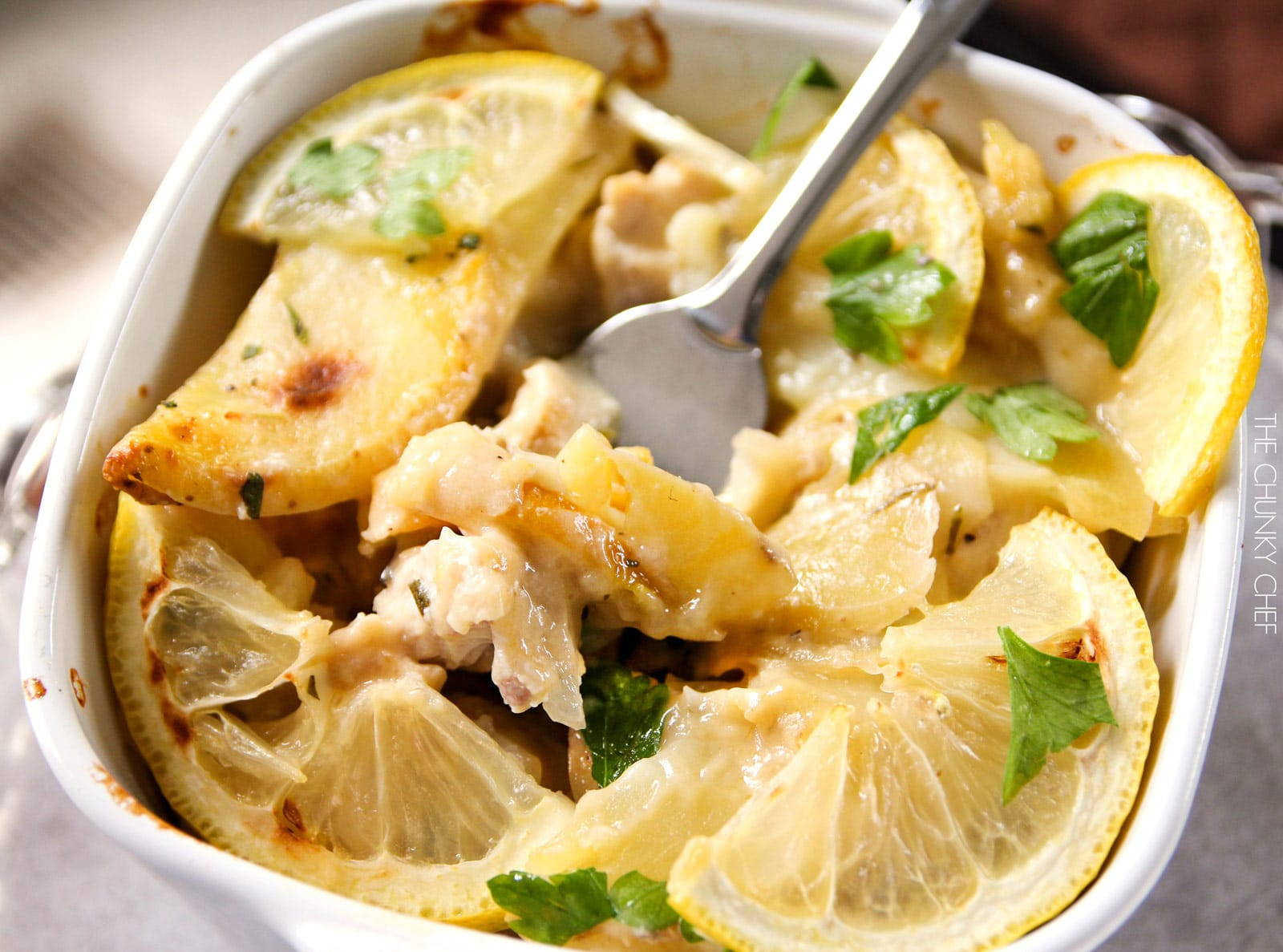 Lemon Chicken and Potato Bake   Chicken and potatoes are baked with lemon slices in a creamy casserole that's sure to fill you up and make you smile!   http://thechunkychef.com