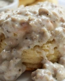 Buttermilk Biscuits and Gravy | Soft and fluffy buttermilk biscuits, perfectly big yet light at the same time, smothered with a creamy homemade sausage gravy... classic down home cooking! |http://thechunkychef.com