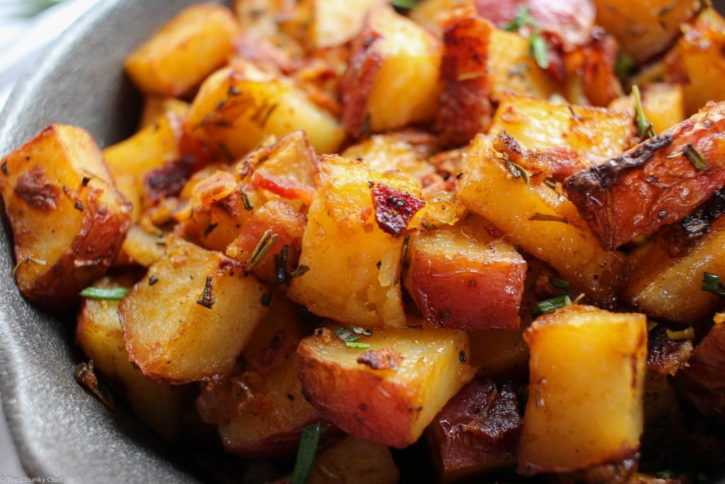 Perfectly seasoned and roasted red-skin potatoes topped with caramelized onions, crispy bacon and fresh herbs. The perfect side dish for breakfast!
