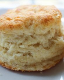 Soft and fluffy buttermilk biscuits, perfectly big yet light at the same time, smothered with a creamy homemade sausage gravy... classic down home cooking!