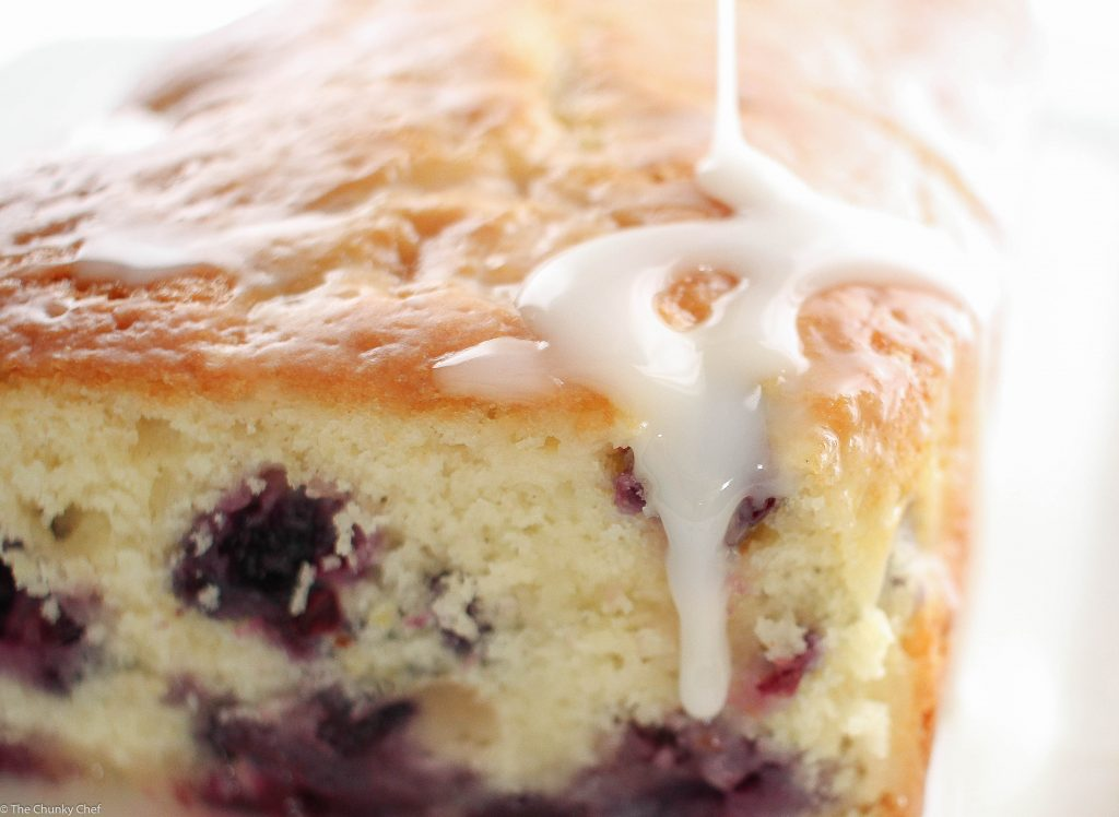 Blueberry Lemon Bread - Sweet bread studded with fresh blueberries, hints of lemon, and drizzled with a decadent lemon cream cheese glaze