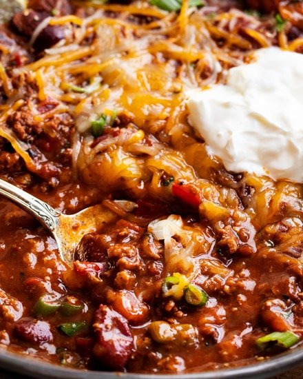 Rich hearty chili, made with beef or turkey!  Since it's made in the Instant Pot, it tastes like it simmered for hours - yet it's ready in 40 minutes! #instantpot #pressurecooker #chili #chilirecipe #beef #turkey #comfortfood #dinner #easyrecipe #beans