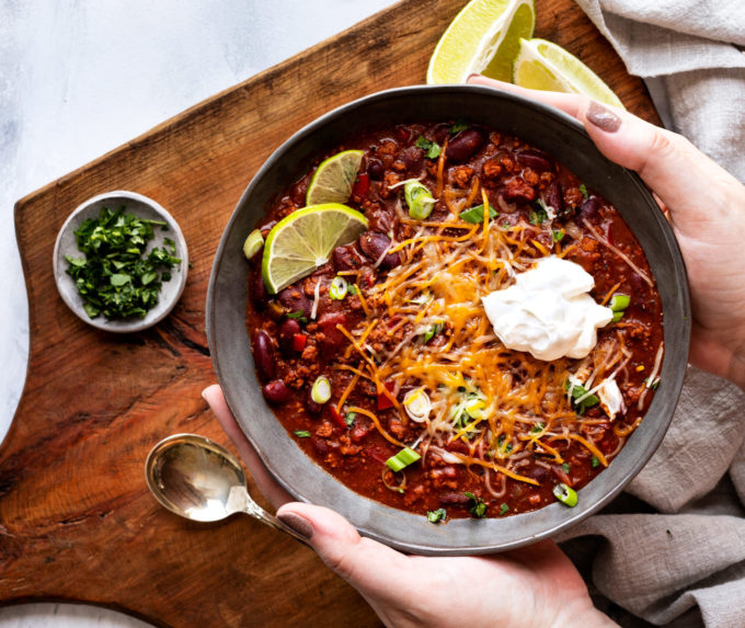 Holding a bowl of Instant pot chili