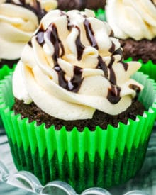 Moist and rich chocolate cupcakes baked with Guinness beer, topped with a silky Irish cream frosting, and drizzled with an Irish cream chocolate sauce! #chocolate #cupcakes #stpatricksday #stpattysday #baking #dessertrecipe #guinness #irishcream
