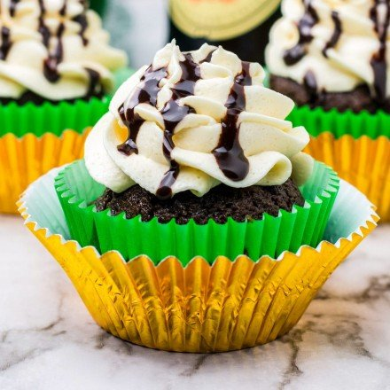 chocolate cupcakes made with guinness in gold and green wrappers
