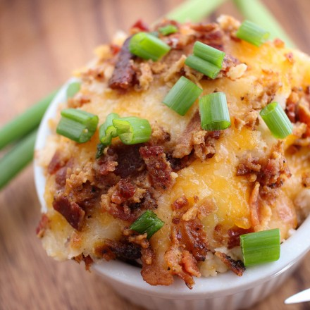 Loaded Mashed Potatoes Bake - All the flavors of your favorite loaded mashed potatoes, baked to creamy perfection. The perfect side dish for the whole family to enjoy!