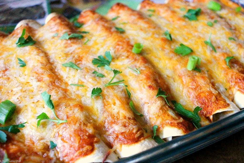 These beef enchiladas are filled with a flavorful beef, bean and chili mixture, covered in a delicious homemade sauce and smothered in gooey cheese!