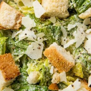 Perfect restaurant-style Caesar salad with homemade dressing and homemade garlic croutons.  Amazing as a side salad, or add some grilled chicken and make it a meal! #salad #dressing #saladdressing #caesar #homemade #croutons #fromscratch