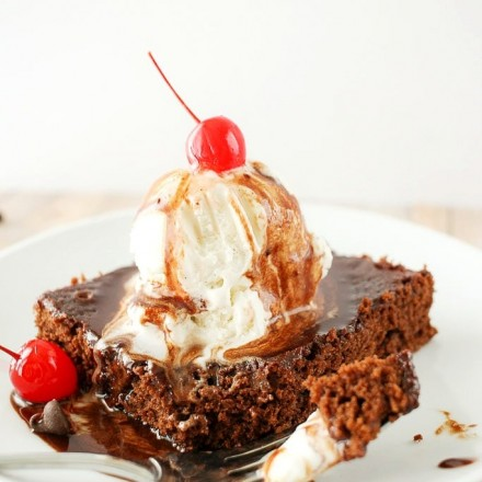 Deliciously fudgy brownies made with Coca-Cola, topped with a generous scoop of vanilla bean ice cream, and drizzled with a coca cola chocolate sauce!