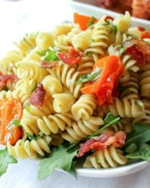 A light, fresh, and mayo-free pasta salad with all the flavor notes of your favorite gourmet BLT!! Bring this to your next party!