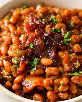 These Brown Sugar and Bacon Baked Beans are the perfect blend of sweet, savory and smoky! Topped with delicious bacon, they're always a hit, and are SO easy to make! #bakedbeans #beans #baked #bacon #brownsugar #potluck #bbq #summer #cookout #easyrecipe