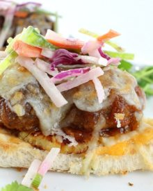 These Hawaiian meatball sliders are juicy, cheesy, sweet with a little spicy kick, and topped off with a crunchy and flavorful jicama slaw!
