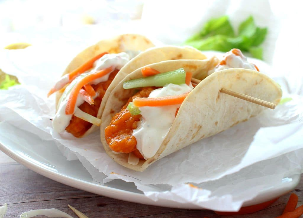 A combination of two classic foods... buffalo chicken wings and mini tacos. Complete with crunchy carrot and celery slaw and creamy blue cheese dressing!