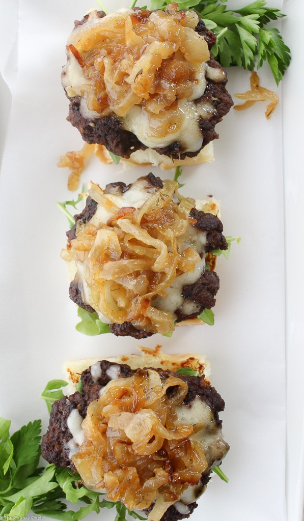 Caramelized Onion Beef Sliders | The Chunky Chef | Ground beef sliders smothered in melted gruyere cheese, topped with caramelized onions and thyme, peppered bacon and a flavorful A1 mayo!