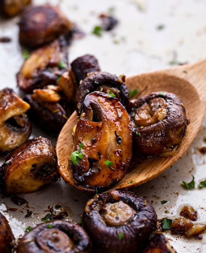 roasted mushrooms on serving spoon