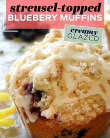 Tender and moist blueberry muffins topped with a crunchy streusel and drizzled with a decadent creamy glaze! Great for breakfast OR dessert! #muffins #blueberry #blueberrymuffins #streusel #glazed #breakfast #breakfastrecipes #baking