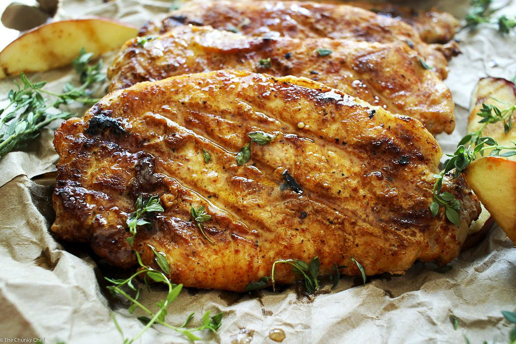 """Apple Cider Orange and Thyme Grilled Pork Chops   The Chunky Chef   Summer meets Fall in these apple cider orange and thyme grilled pork chops.. deliciously juicy and tender with a finger-licking glaze! A """"must try"""" recipe!"""