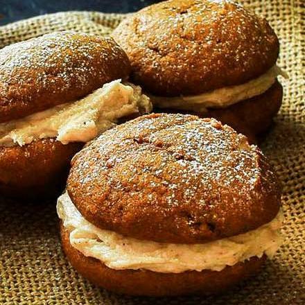Soft and light spiced pumpkin cookies sandwiched together with a decadent, yet easy to make, browned butter maple cinnamon frosting! #fallbaking #baking #cookies #whoopiepies #pumpkin #pumpkinspice #maple