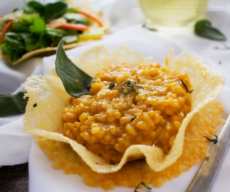 Pumpkin Risotto in Parmesan Bowls | Classic Fall flavors come together in this ultra creamy pumpkin risotto topped with fresh sage and a sprinkle of Parmesan... served in edible bowls!!
