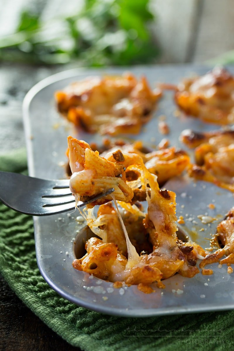 Cheesy One Bite Baked Penne Cups   Creamy, cheesy and spicy baked penne pasta is baked into mini muffin cups for the tastiest appetizer around! They're the perfect one-bite snack!