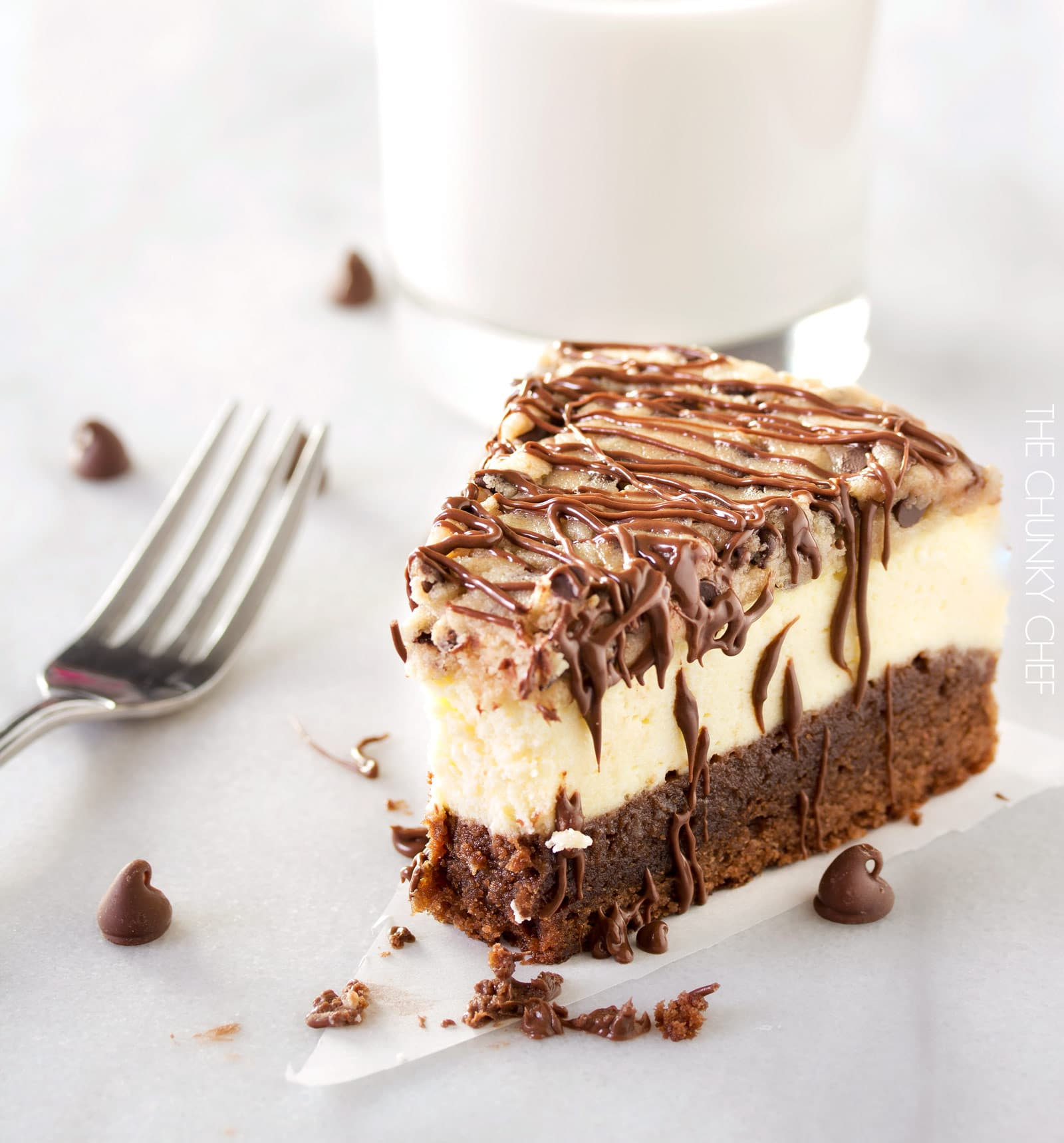 Brownie Bottom Cookie Dough Cheesecake |  This impressive, yet super easy, brownie bottom cookie dough cheesecake looks as fancy as any dessert you've had from a restaurant!  The ULTIMATE cheesecake for the ULTIMATE dessert lover!  |  http://thechunkychef.com