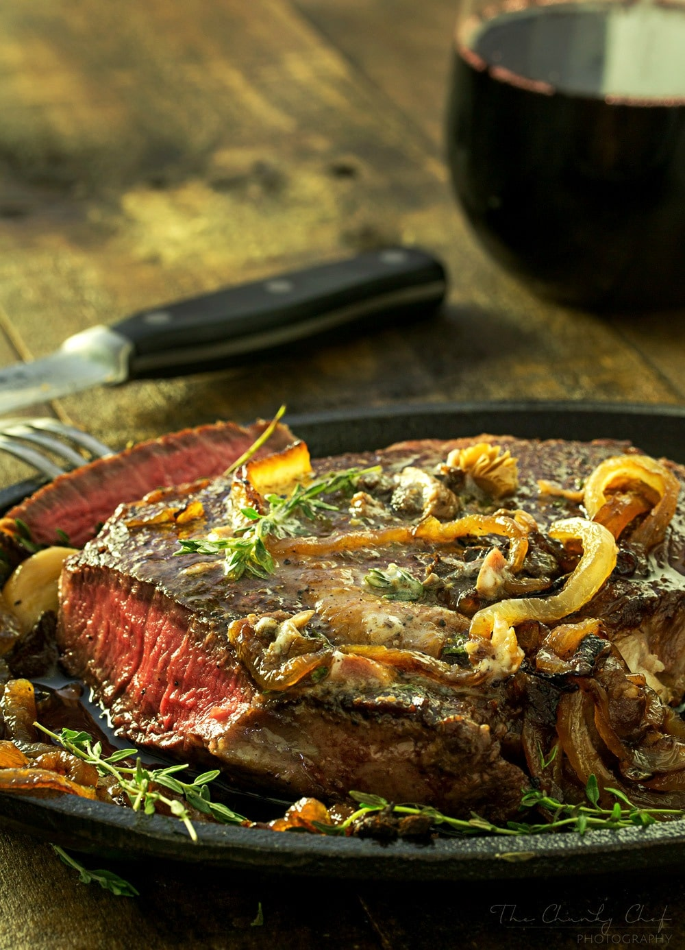 Pan Seared Steak |Tender steak is pan seared and oven roasted to juicy perfection, then topped with a porcini mushroom and herb compound butter and caramelized onions! |http://thechunkychef.com