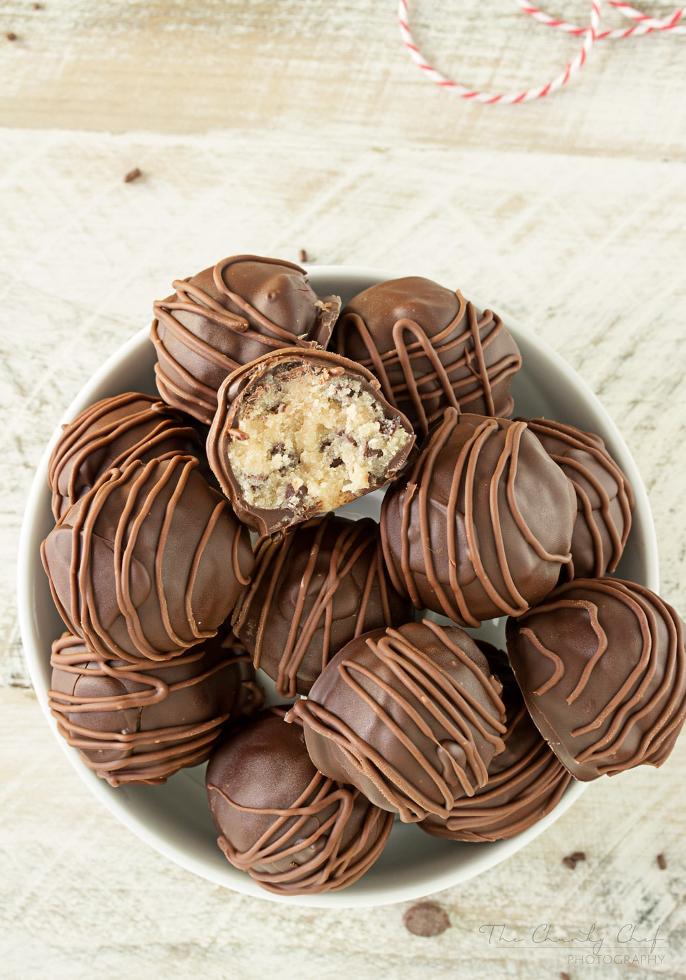 Triple-Chocolate-Cookie-Dough-Truffles | These cookie dough truffles are made from an egg-less cookie dough with semi sweet chocolate chips, then coated in two different kinds of chocolate! | http://thechunkychef.com