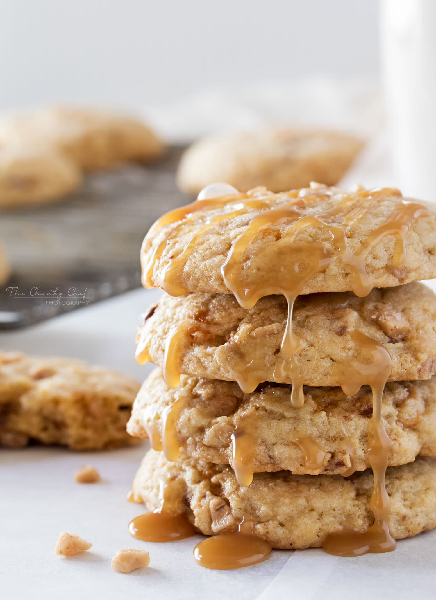 Chewy Butterfinger Toffee Cookies   Soft, chewy and buttery.. these toffee cookies are studded with Butterfinger pieces and chewy bits of toffee. Drizzle them with caramel for extra decadence!   http://thechunkychef.com
