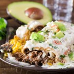 Queso Smothered Beef Barbacoa Chimichangas | Tender, spicy, slow cooked beef barbacoa stuffed into a tortilla and fried to crunchy perfection, then smothered in a velvety smooth white queso! | http://thechunkychef.com