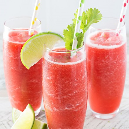 Boozy Strawberry Limeade Slushies | Just 5 ingredients, including ice, and you're on your way to slushy heaven! | http://thechunkychef.com