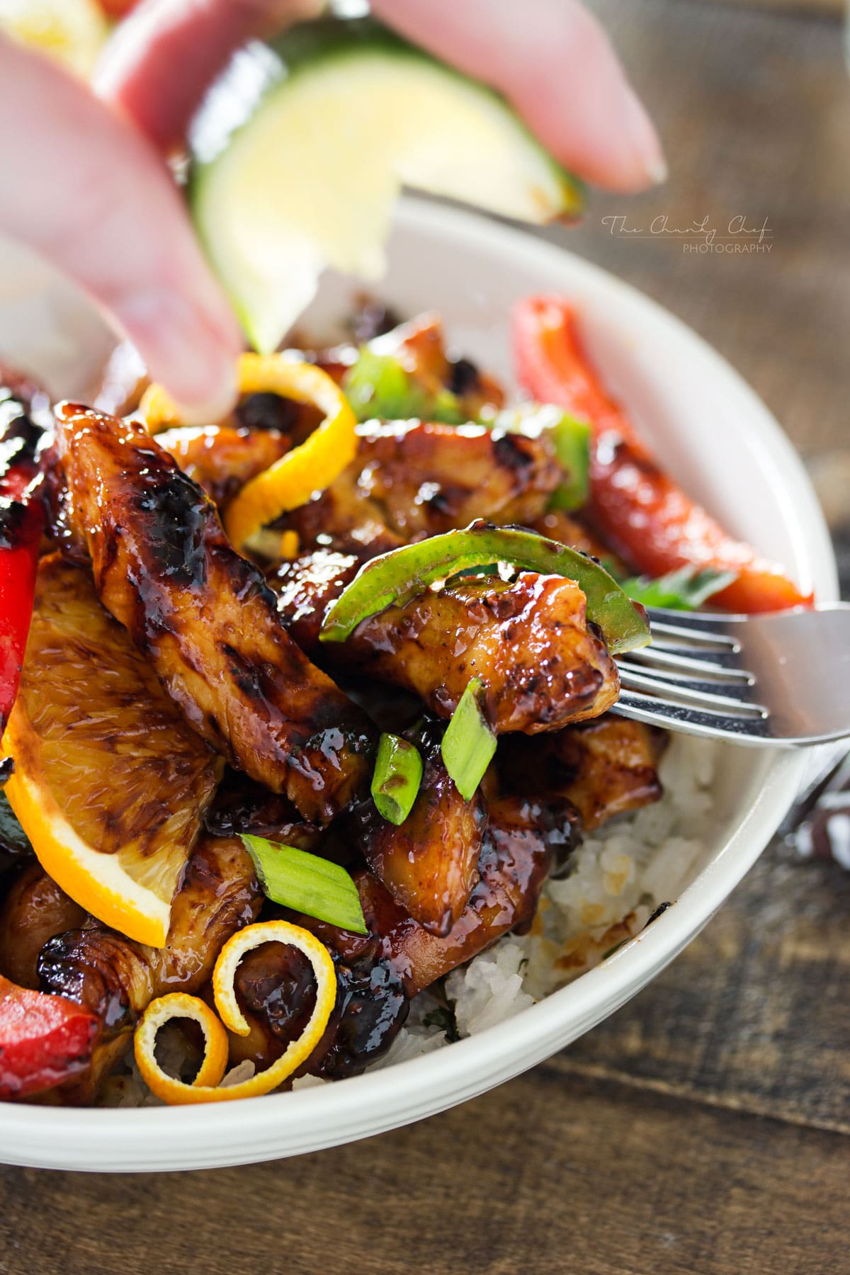 Cajun Honey Glazed Chicken Bowls | This Cajun honey glazed chicken bowl is packed with bright, fresh ingredients! The chicken is actually cooked IN the marinade, allowing for maximum flavor. | http://thechunkychef.com