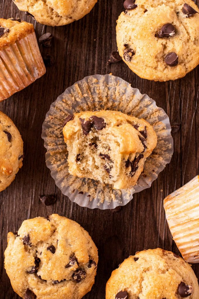unwrapped chocolate chip muffin with bite taken out of it