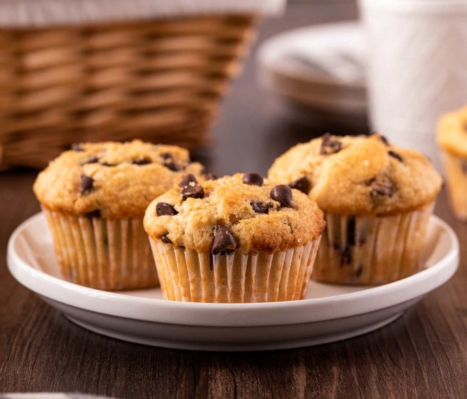 three chocolate chip muffins on a plate