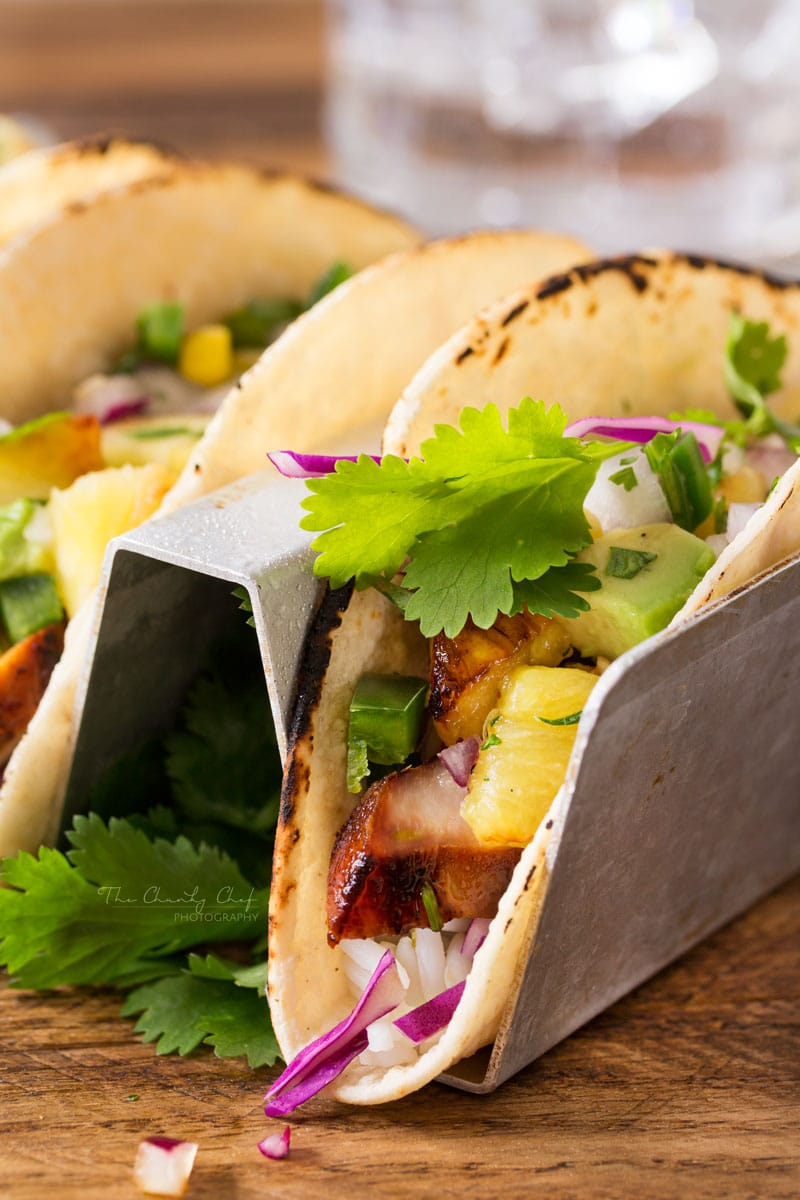 Tequila-Lime-Chicken-Tacos | Tender, juicy, tequila lime chicken is nestled into soft corn tortillas and topped with a smoky sweet grilled pineapple salsa for the most delicious tacos! | http://thechunkychef.com