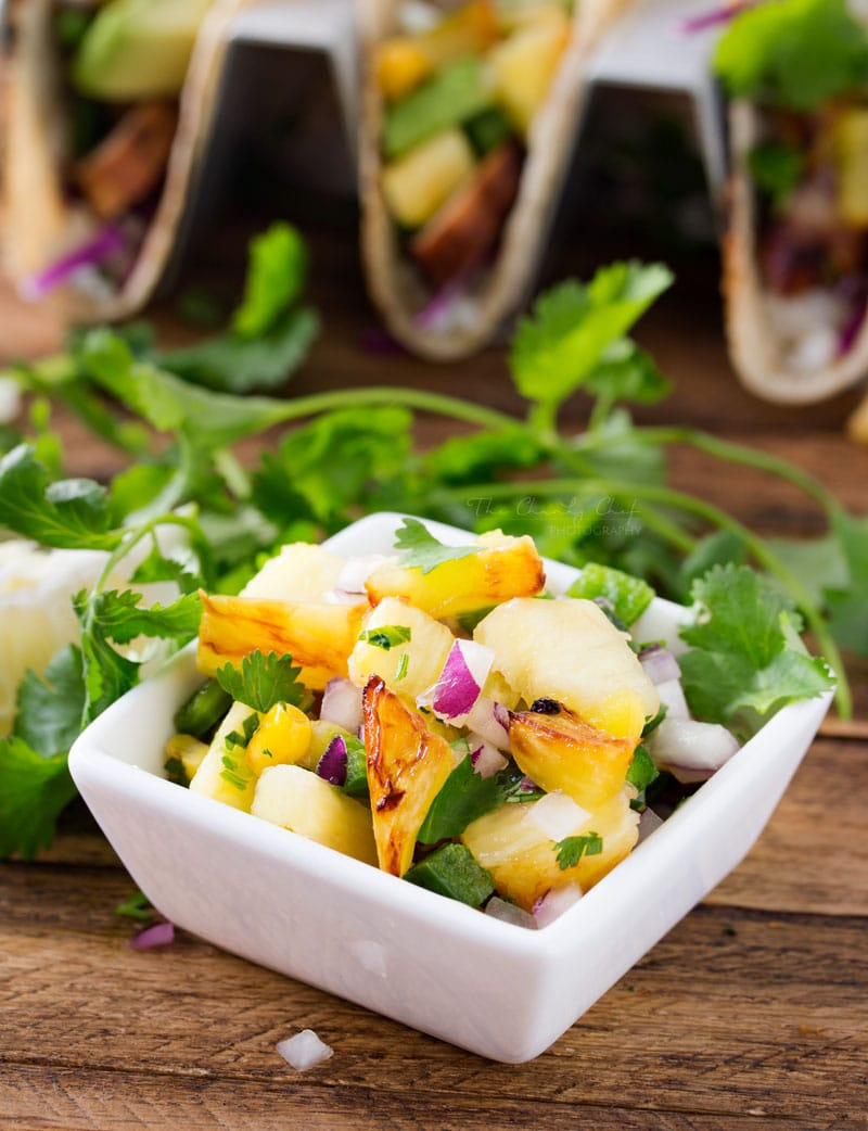 Tequila Lime Chicken Tacos | Tender, juicy, tequila lime chicken is nestled into soft corn tortillas and topped with a smoky sweet grilled pineapple salsa for the most delicious tacos! | http://thechunkychef.com