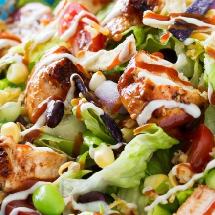 BBQ Chicken Salad | This fresh and crisp bbq chicken salad is packed with veggies, tender grilled chicken, and topped with bbq sauce and a green chile ranch dressing! | http://thechunkychef.com