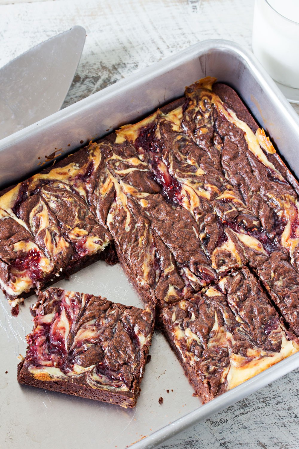 Raspberry Cheesecake Brownies | Rich, fudgy brownies are topped with a creamy cheesecake layer that's been swirled with sweet raspberry jam. The best cheesecake brownies! |http://thechunkychef.com