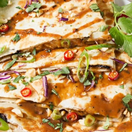 Thai Peanut Chicken Quesadillas | Thai chicken gets a fusion twist in these Thai peanut chicken quesadillas! Loaded with flavor and fun to make, try them tonight! | http://thechunkychef.com