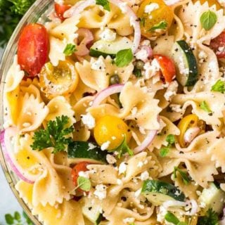 Always a crowd-pleaser, this pasta salad has won first place in several potluck contests. Summer vegetables, tender pasta, salty cheese, and a mouthwatering zesty dressing! #pastasalad #potluck #bbq #italian #greek #mediterranean #pasta, #salad #makeaheadrecipe #easyrecipe