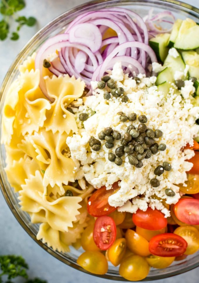 Ingredients for pasta salad in bowl
