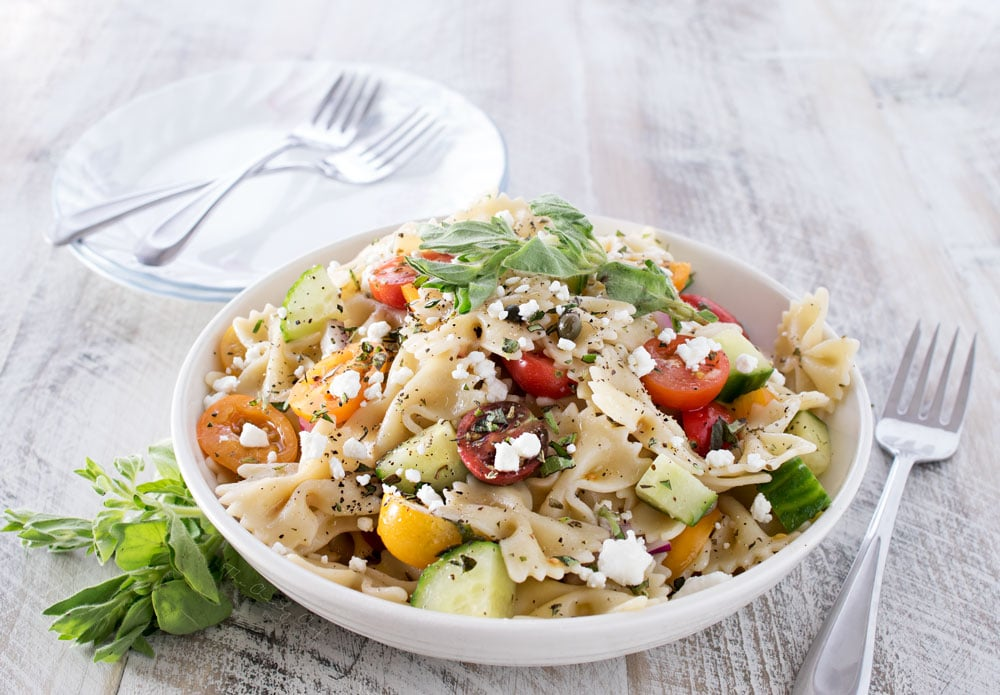 Mediterranean Pasta Salad | Step up your pasta salad game with this fresh and colorful Mediterranean pasta salad with a red wine vinegar and herb dressing! Homemade is always the best! | http://thechunkychef.com