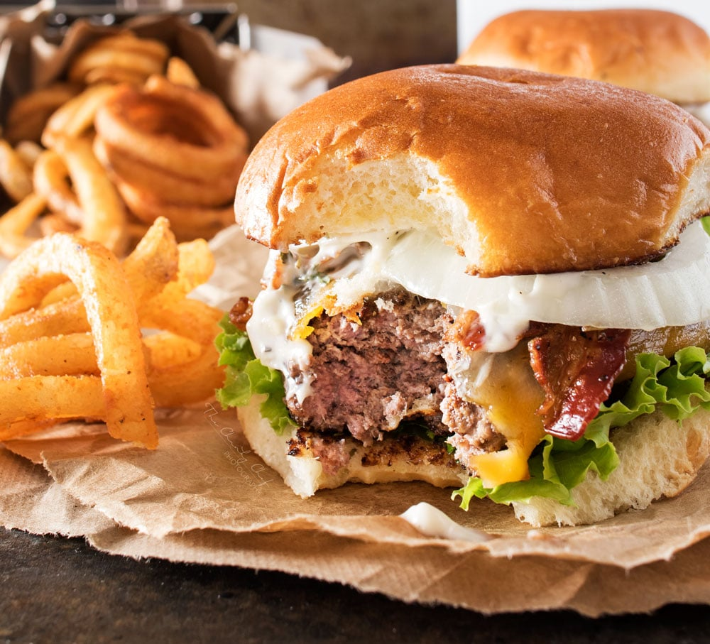 Pepper Crusted Bacon Cheeseburgers   Nothing beats a great burger. Except delicious pepper crusted bacon cheeseburgers, slathered with a garlic aioli! Make burger night one to remember!   http://thechunkychef.com