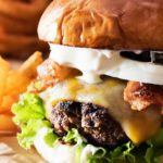 Pepper Crusted Bacon Cheeseburgers | Nothing beats a great burger. Except delicious pepper crusted bacon cheeseburgers, slathered with a garlic aioli! Make burger night one to remember! | http://thechunkychef.com