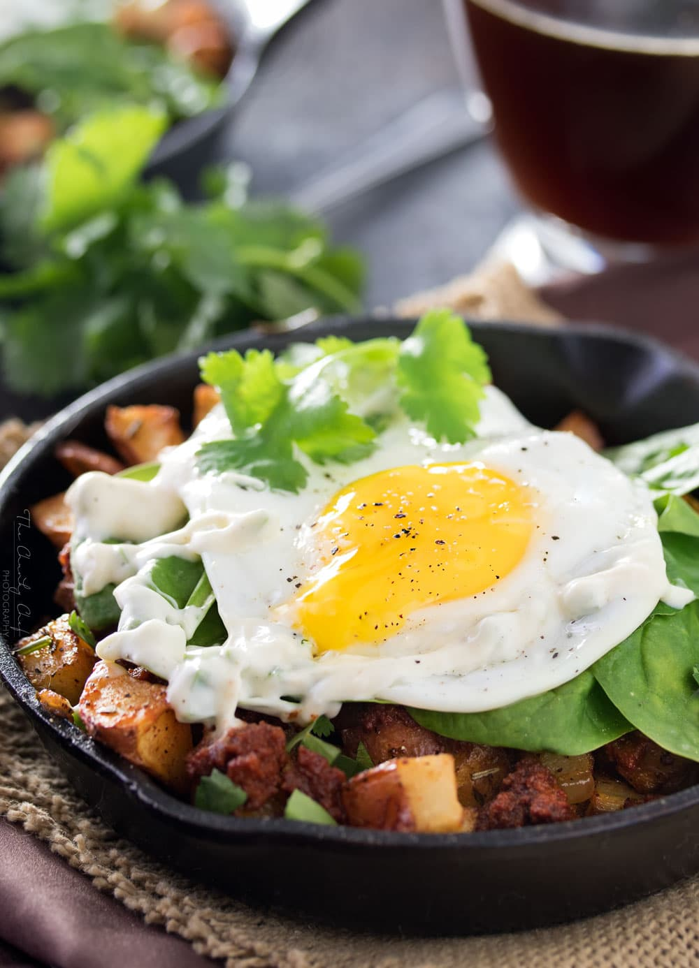 Chorizo Potato Hash with Jalapeno Aioli | Kick your breakfast up a notch with this delicious chorizo potato hash, topped with a sunny side up egg and drizzled with a homemade jalapeno aioli! |http://thechunkychef.com