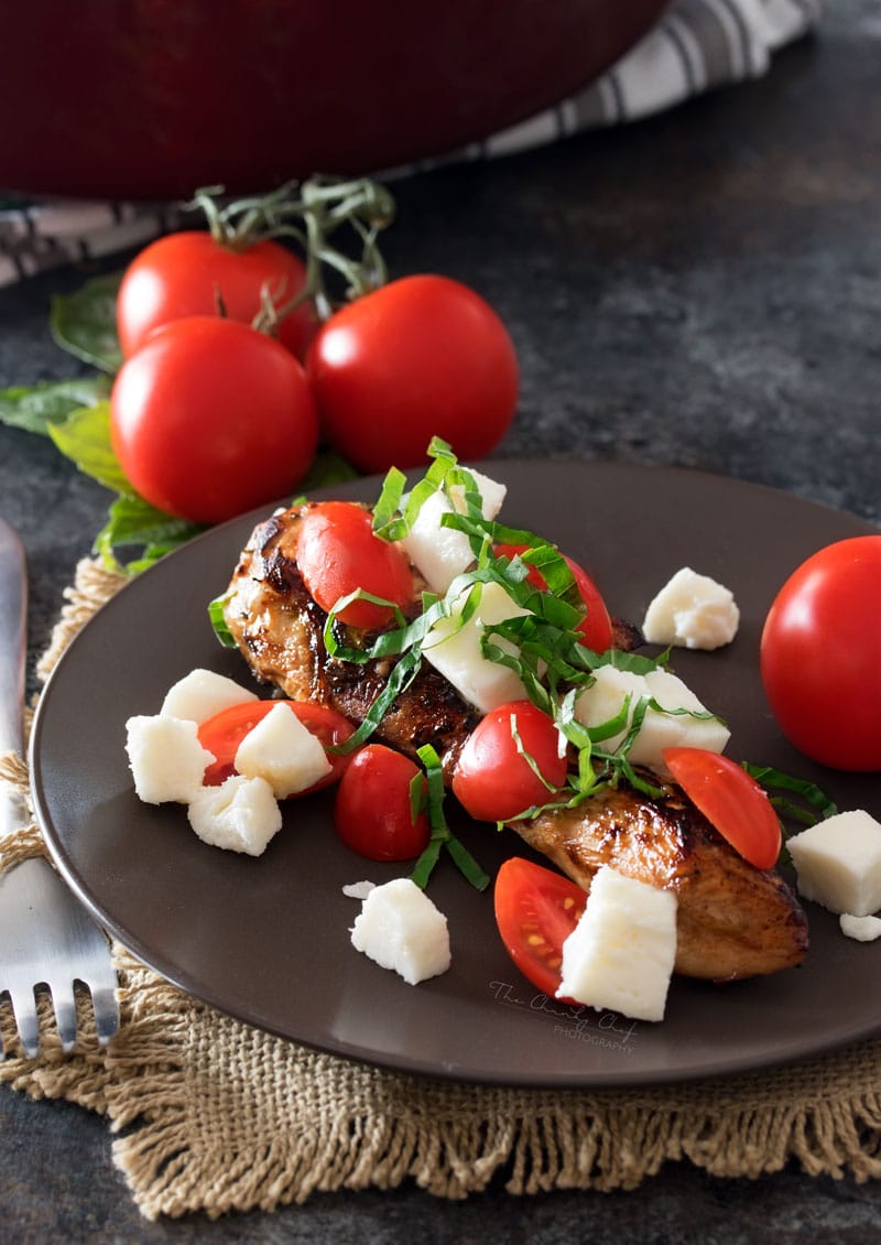 Garlic Balsamic Caprese Chicken | Juicy caprese chicken, marinated in a garlic balsamic marinade, is baked to perfection with burst cherry tomatoes, melted mozzarella cheese, fresh basil! | http://thechunkychef.com