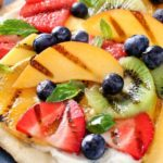 Grilled Fruit Pizza | Flatbread spread with a glorious honey herb whipped ricotta, topped with delicious grilled fruit, drizzled with honey and sprinkled with fresh herbs! | http://thechunkychef.com